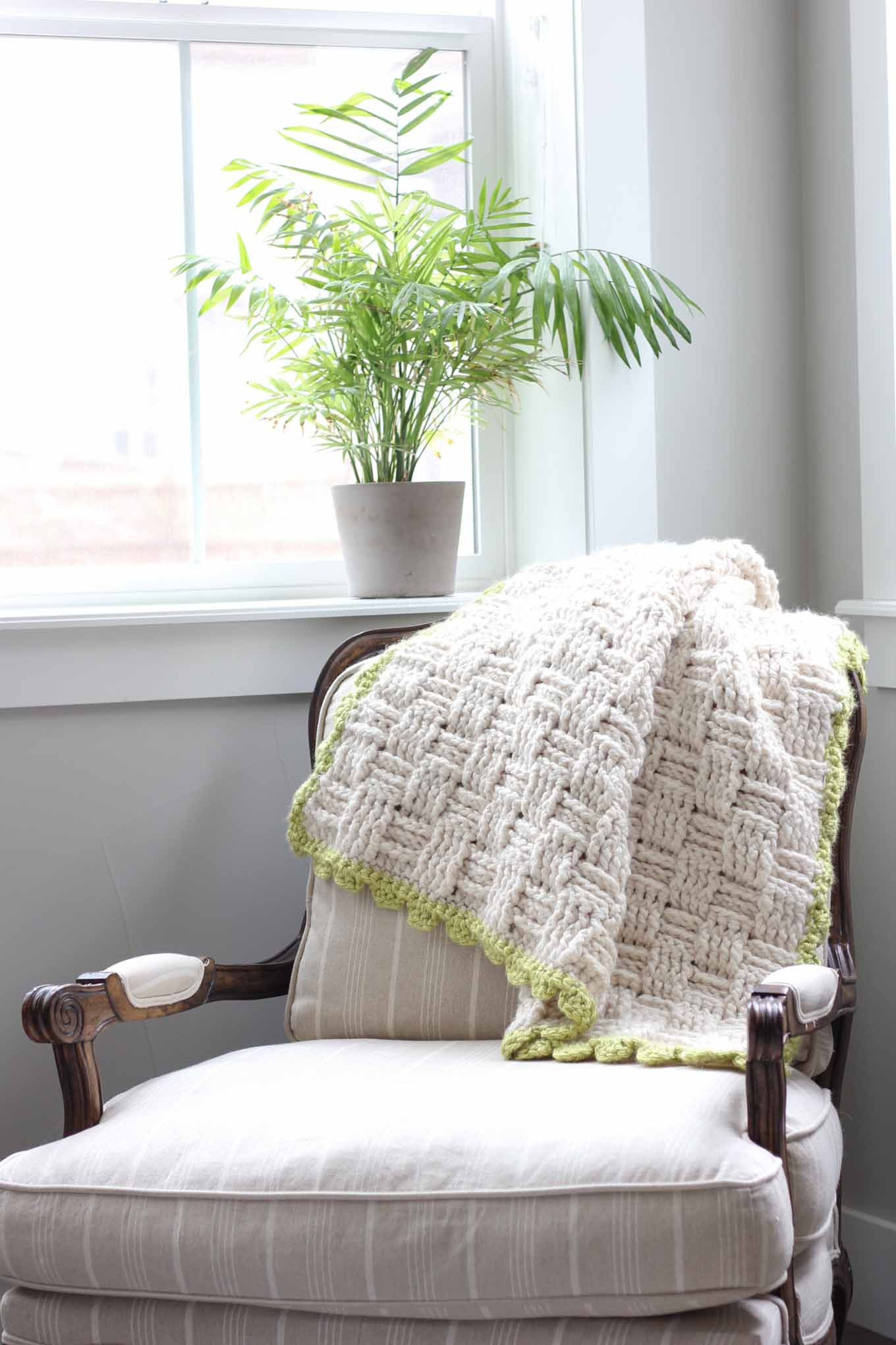 "Squishy yarn heaven! This free crochet basket weave blanket pattern is blooming with texture and makes a perfect lapghan-sized afghan. Made with Lion Brand Wool-Ease Thick & Quick in ""Fisherman"" and Hometown USA in ""Monteray Bay."" 