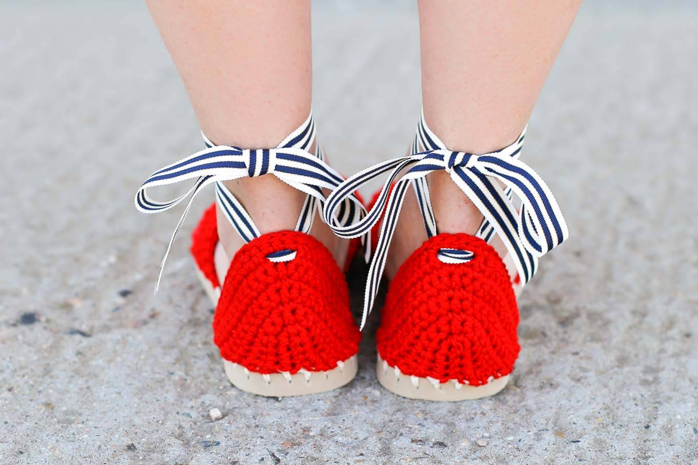 "Preppy crochet pattern! Learn how to make crochet espadrilles with flip flop soles in this free pattern and tutorial from Make and Do Crew! These crochet sandals feature Lion Brand 24/7 Cotton in ""Red."""