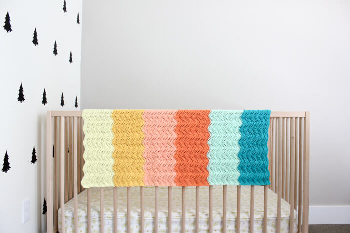 Gorgeous! Every new baby deserves a warm welcome into the world and this easy gender neutral crochet baby blanket pattern puts a modern twist on the traditional ripple. Made using Lion Brand's Baby Soft yarn.