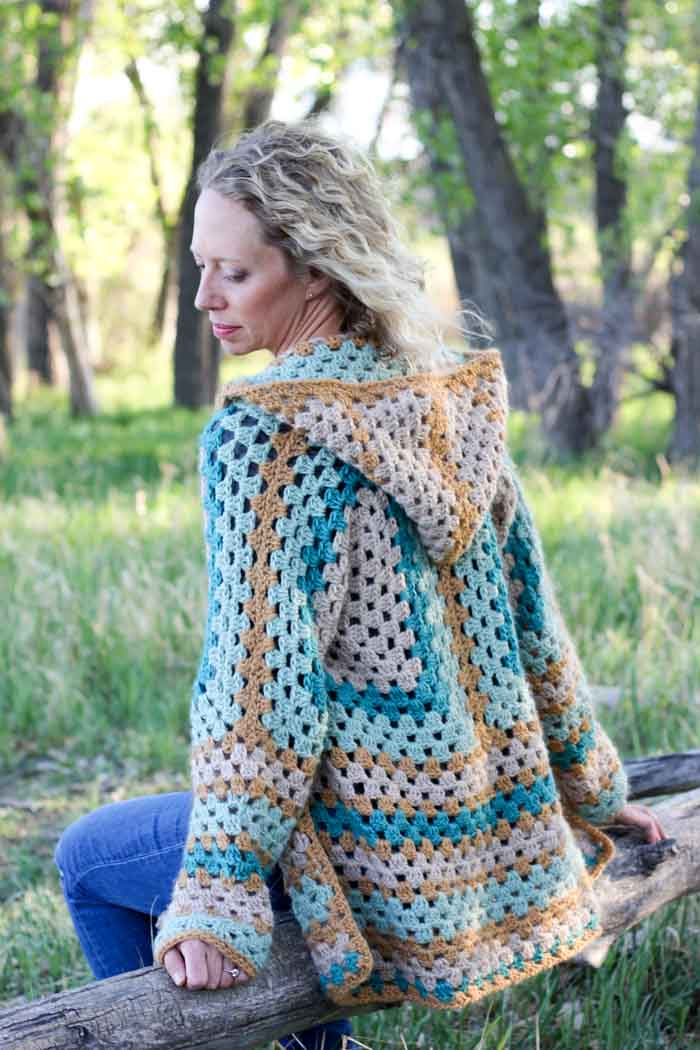 "Believe it or not, two simple granny hexagons are the foundation of this free crochet hexagon sweater pattern. ""The Campfire Cardigan"" is made with Lion Brand New Basic 175 in Juniper, Cafe Au Lait, Thyme and Camel. Easily make this modern boho crochet sweater pattern!"