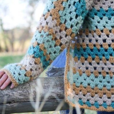 """Believe it or not, two simple granny hexagons are the foundation of this free crochet hexagon sweater pattern. """"The Campfire Cardigan"""" is made with Lion Brand New Basic 175 in Juniper, Cafe Au Lait, Thyme and Camel. Modern crochet sweater sleeve."""