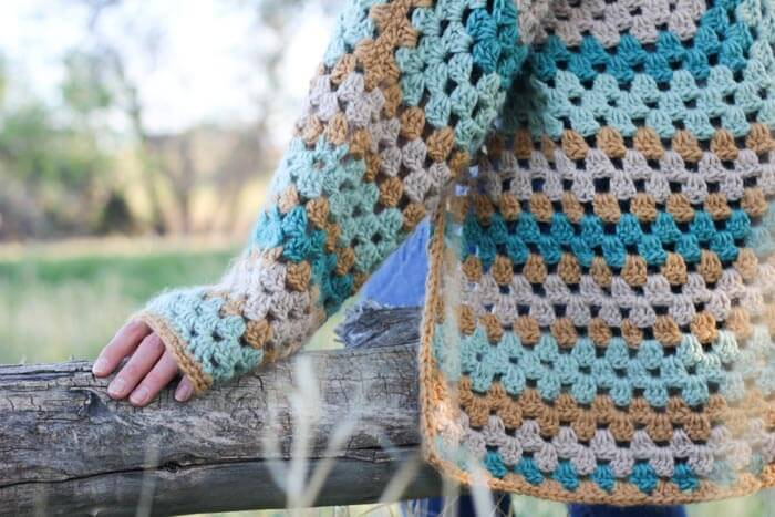 "Believe it or not, two simple granny hexagons are the foundation of this free crochet hexagon sweater pattern. ""The Campfire Cardigan"" is made with Lion Brand New Basic 175 in Juniper, Cafe Au Lait, Thyme and Camel. Modern crochet sweater sleeve."