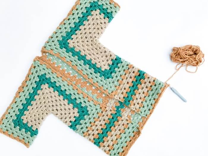 "Not your granny's granny stitch! In Part 2 of this free crochet sweater pattern, we'll learn how to lengthen the bottom of your ""Campfire Cardigan"" and add sleeves. Made with Lion Brand New Basic 175 yarn."