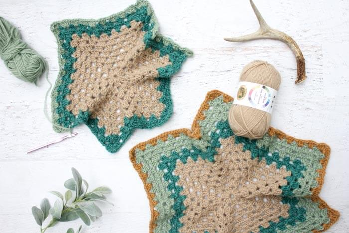 "Believe it or not, two simple granny hexagons are the foundation of this free crochet hexagon sweater pattern. ""The Campfire Cardigan"" is made with Lion Brand New Basic 175 in Juniper, Cafe Au Lait, Thyme and Camel."