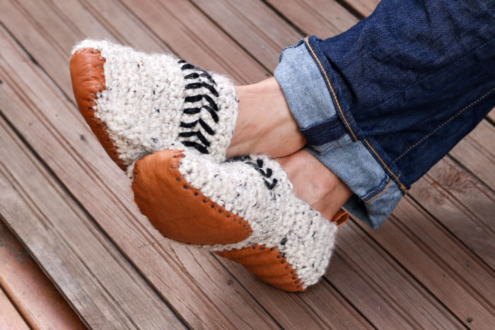 "Free adult crochet slippers pattern makes the perfect quick DIY gift! Free adult crochet slippers pattern and leather sole template from MakeAndDoCrew.com. Made with Lion Brand Wool-Ease Thick & Quick in ""Oatmeal."" #winteriscoming #wooliscoming"