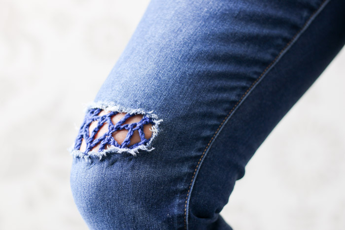 Do your jeans need a facelift? Learn how to patch jeans with crochet lace in this simple how-to tutorial! There's even a free crochet doily patch pattern made with Lion Brand 24/7 Cotton.