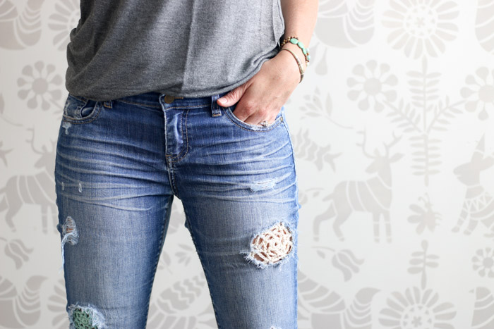 Jeans that have been patched with lace crochet doilies. Such a fun boho style! Full how to tutorial from Make & Do Crew.