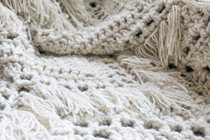 Lion Brand Wool-Ease Thick & Quick makes the perfect yarn for this chunky crochet ripple afghan pattern. Get the free pattern for the Sedona Throw from Make and Do Crew.