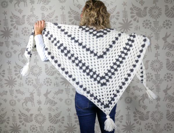 "Put a modern spin on a crochet classic with this simple crochet granny stitch shawl! This free crochet pattern uses Lion Brand New Basic 175 in ""Cream"" and ""Charcoal."""