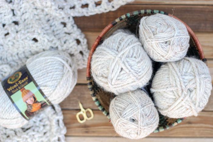 """Lion Brand Wool-Ease Thick & Quick in """"wheat"""" being used for a chunky crochet blanket pattern. Get the free Sedona Throw pattern from Make & Do Crew."""