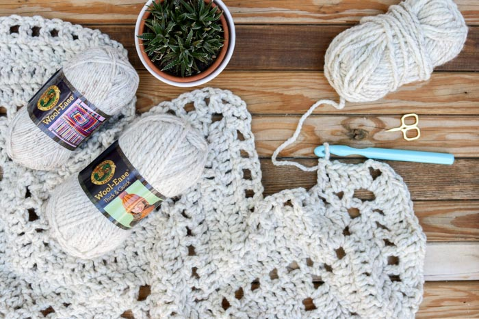 "Lion Brand Wool-Ease Thick & Quick in ""wheat"" being used for a chunky crochet blanket pattern. Get the free Sedona Throw pattern from Make & Do Crew."