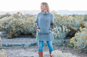 """This simple free crochet poncho pattern is a little more fitted than most, offering a versatile wardrobe staple that's perfect for layering. The pocket and cowl turtleneck crank up the cozy factor! Made with Lion Brand Touch of Alpaca yarn in """"Grey Oxford."""""""