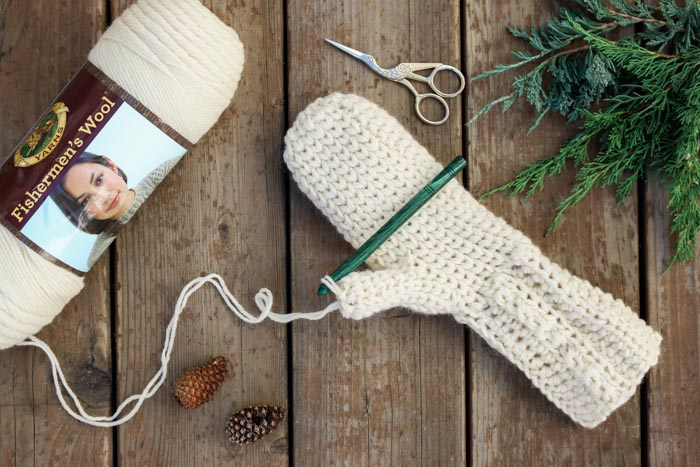 This is crochet?! This free crochet mitten pattern uses the waistcoat stitch (aka the center single crochet stitch) to create a classic knit look. And the Lion Brand Fishermen's Wool makes them naturally water resistant! Get the free Morning Mittens pattern from Make & Do Crew.