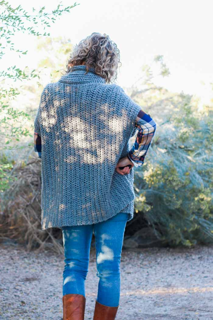 This worsted weight crochet poncho is easy to crochet and great for confident beginners. Free pattern!
