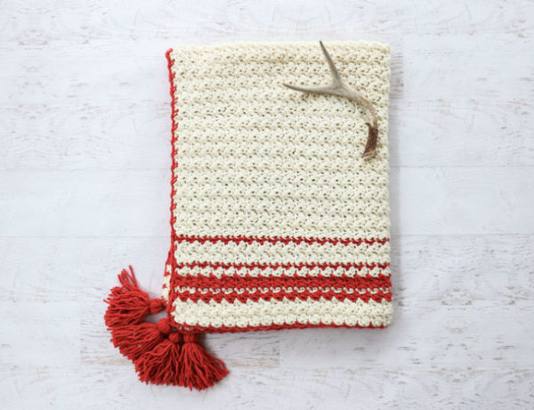 Inspired by classic woven blankets, the Hygge Holiday Throw turns any chair or couch into an inviting spot to curl up. Despite being full texture, this beginner crochet blanket pattern uses very simple crochet stitches (and there's a video tutorial!)