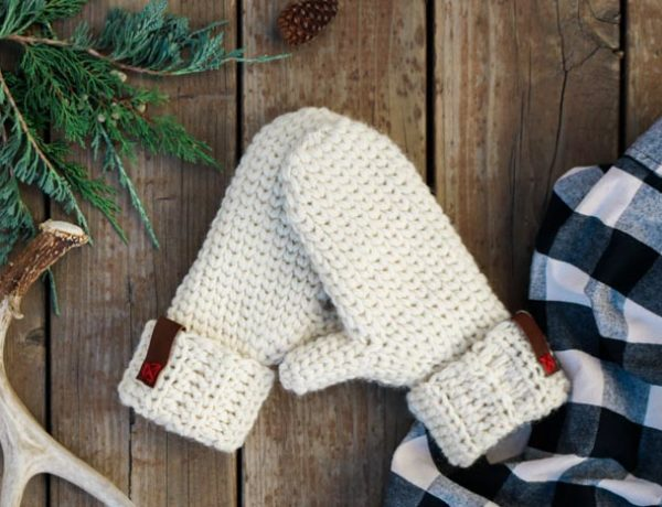 "This free crochet mitten pattern uses cozy wool and a knit-looking stitch to create a timeless mitten style that's great for personalizing and gift giving. This free pattern from Make & Do Crew features Lion Brand Fishermen's Wool in the color ""natural."""