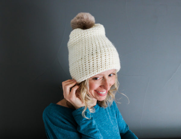Have you ever wondered how to make crochet look knit? This free crochet hat pattern for beginners uses the waistcoat stitch to create the look of knitting. It's an easy beanie to make for men or women. Free pattern by Make & Do Crew featuring Woolspun yarn.