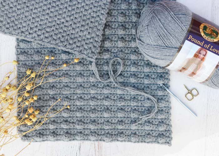 Use the crochet spot stitch as part of this free crochet bean bag pattern using Lion Brand Pound of Love in Grey Oxford. Free pattern and tutorial from Make & Do Crew!