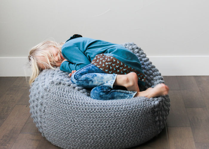 This cozy crochet bean bag is the perfect free pattern for a nursery or kids room.