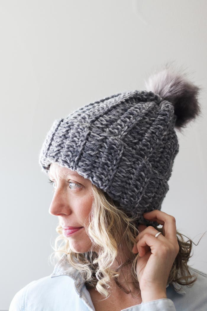 "This free beginner crochet hat pattern is a perfect example of how to make crochet look like knitting using simple double crochet stitches. Featuring Lion Brand Wool Ease Tonal yarn in the color ""Smoke."""