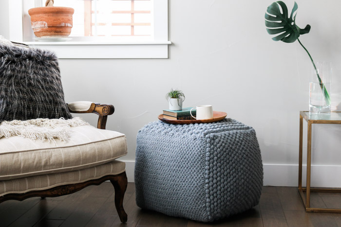 Learn some new stitches while crocheting your own oversized pouf ottoman. This free crochet bean bag pattern is comprised of six simple squares and stuffed with inexpensive household items to create a high-end looking piece of DIY furniture.