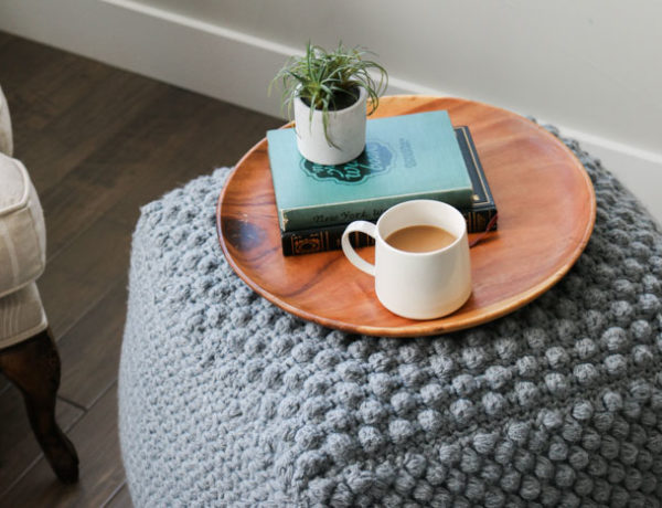 How to crochet a bean bag or pouf that you can use as an end or side table. Free crochet pattern using Lion Brand Pound of Wool in Grey Oxford.
