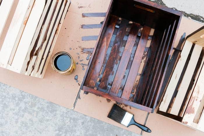 Build modern bookshelves using wooden crates. Perfect craft room organization idea!