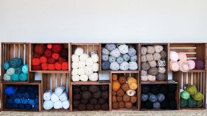 This DIY yarn organization idea is perfect for renters because you can build it with zip ties and take it down easily!