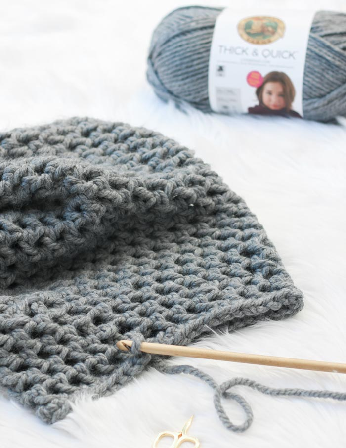 "This is a perfect beginner crochet cowl pattern using Lion Brand Thick & Quick in ""Oxford Grey."""