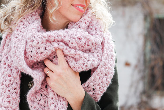 The At First Blush triangle scarf is an easy lace crochet shawl pattern, free from Make and Do Crew featuring Lion Brand Touch of Alpaca yarn.