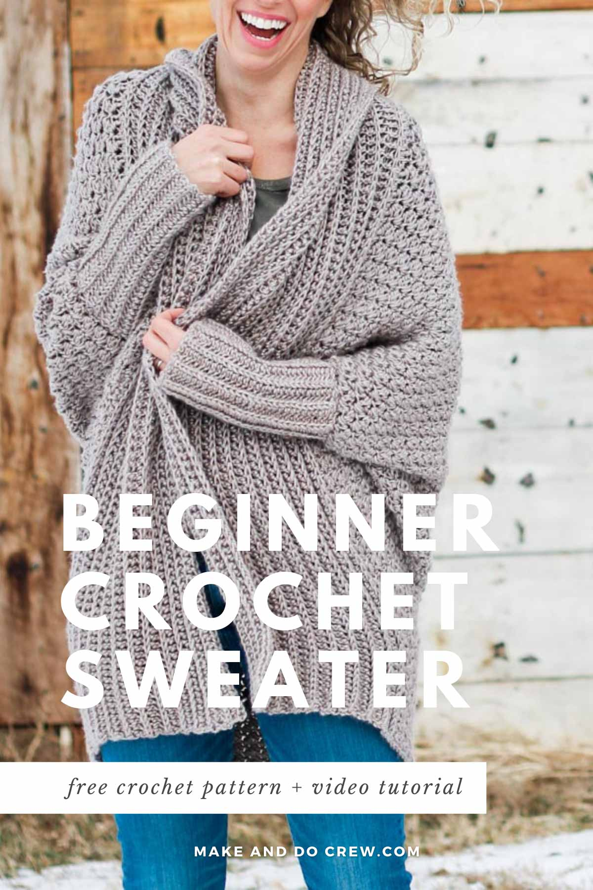 A woman snuggled into a crochet sweater made with the suzette stitch. Free pattern + video tutorial.