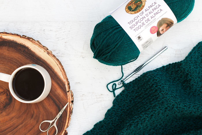 """Free crochet cardigan pattern with plus sizes being being worked in the Griddle Stitch using Lion Brand Yarn Touch of Alpaca """"Jade."""""""