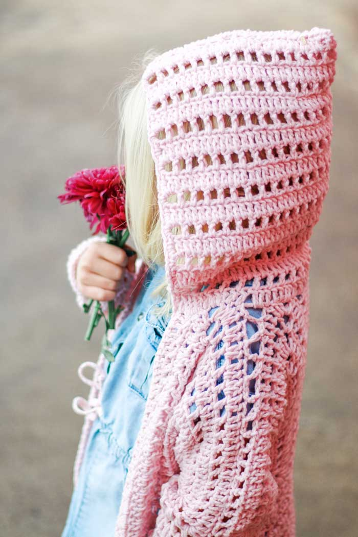 The XO hooded crochet cardigan pattern for girls (sizes newborn, toddler, preschooler, girls and teens).