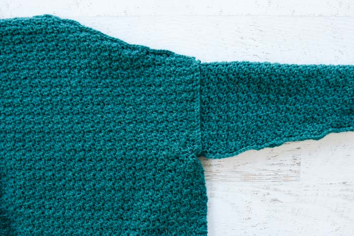 How to crochet a plus sized cardigan sweater step-by-step tutorial. Using the single crochet stitch to seam the shoulders.