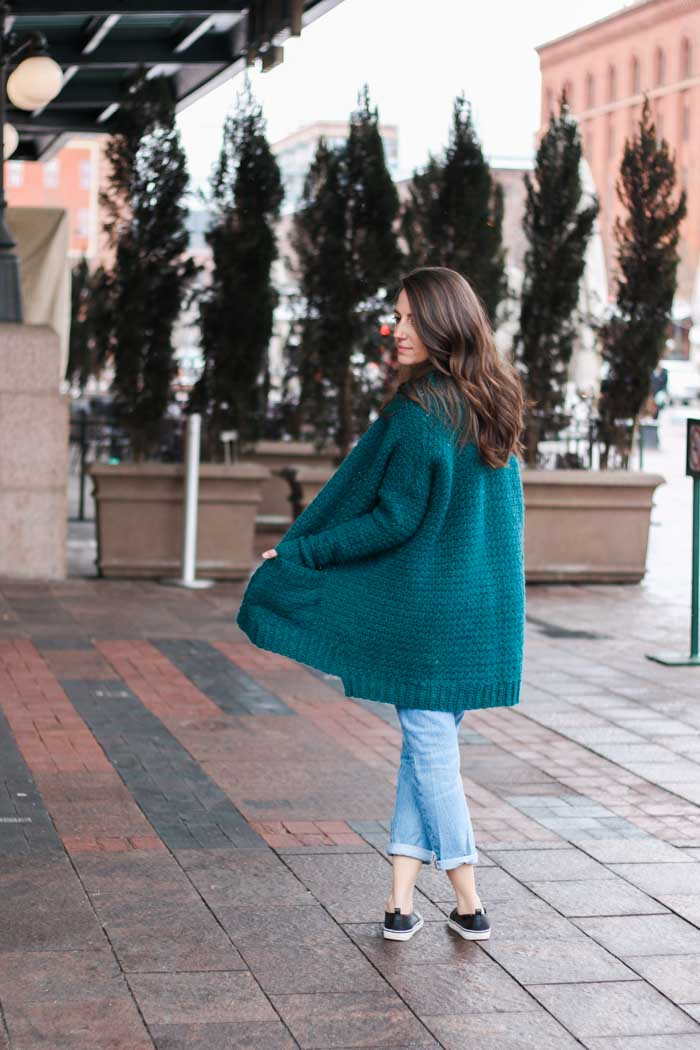 "Love this comfy cardigan crochet pattern! Make & Do Crew says: this pattern has extra long fitted sleeves, pockets and an oversized fit for the perfect stylish, yet comfortable fit. Free crochet pattern includes plus sizes too! (Women's size small-3x) This pattern featured Lion Brand Touch of Alpaca yarn in the color ""Jade."""