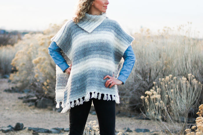 """A simple combination of extended half double crochet and slip stitches make for a knit-looking """"braided"""" texture in this free women's crochet poncho pattern featuring Lion Brand Scarfie Yarn."""