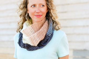 "Easy filet crochet triangle scarf using Lion Brand Mandala yarn in the color ""Serpent."""