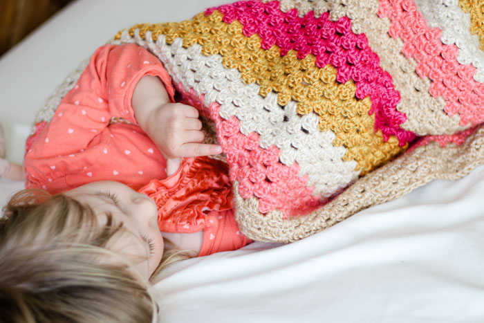 Free baby girl crochet blanket pattern that can be made with Lion Brand Heartland yarn. Very easy to modify for a boy too!