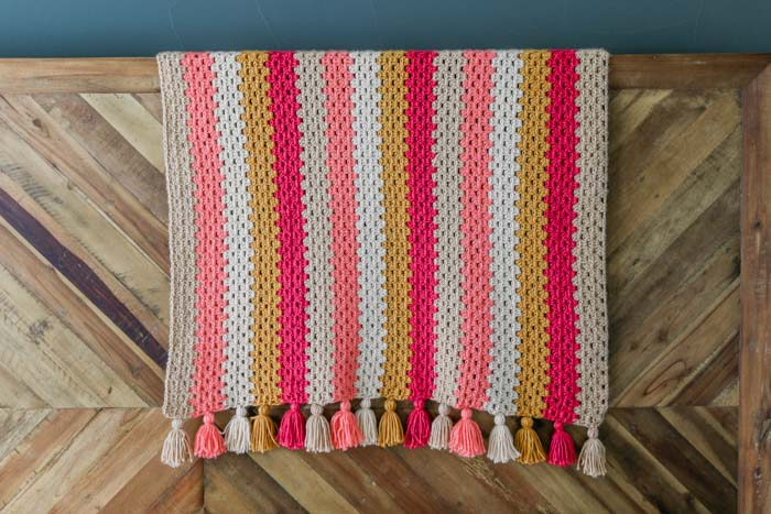 Free crochet granny stripe afghan pattern using Lion Brand Heartland yarn in Great Sand Dunes, Zion, Acadia, Biscayne and Yellowstone. Great beginner friendly crochet blanket pattern.