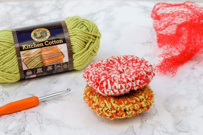 Keep your dishes clean and mesh produce bags out of the landfill at the same time with this simple crochet pot scrubber pattern! Perfect Earth Day craft idea you can use year round. Get the free pattern and tutorial featuring Lion Brand Yarn's Kitchen Cotton.