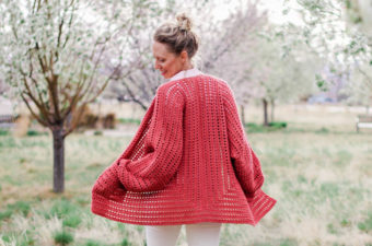 """Easy crochet cardigan pattern made from two simple hexagons. This beginner-friendly free pattern and tutorial includes petite and plus sizes. Made with Lion Brand Yarn Vanna's Style in """"Tomato."""""""