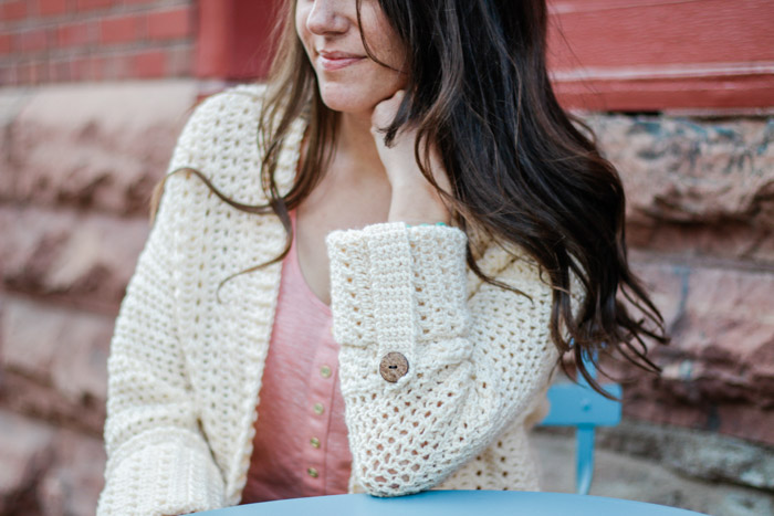 A lightweight summer crochet cardigan with cuffed sleeves and wooden buttons. Free pattern and video tutorial from Make & Do Crew.