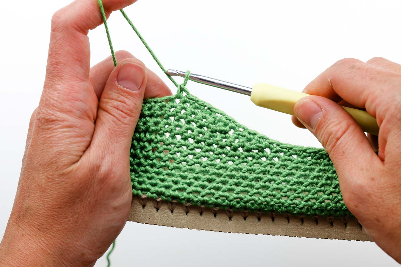 Learn how to crochet your own functional shoes by using Lion Brand 24/7 Cotton yarn and flip flop soles. Free pattern and photo tutorial (with some video) from Make and Do Crew.