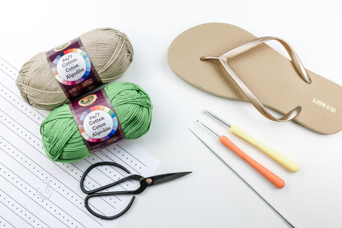 The supplies necessary to learn how to crochet shoes with rubber flip flop soles using Lion Brand 24/7 Cotton.