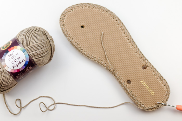 """The first step of creating crochet shoes with flip flop soles using Lion Brand 24/7 Cotton yarn in the color """"Taupe."""""""