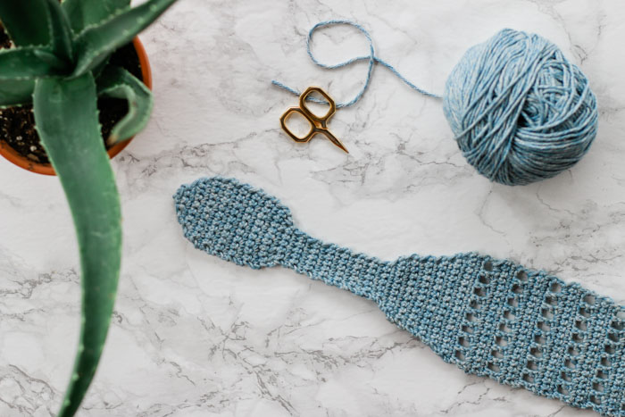 Whether you're a vintage-loving gal or boho queen, this summer crochet knot headband will let you skip a shampoo and look gorgeous doing it. Made with LB Collection Cotton Jeans yarn.