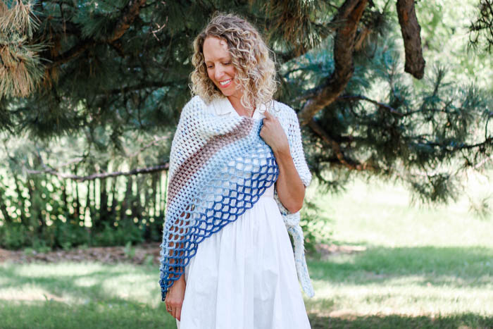 This beautiful crochet shawl pattern is made from an asymmetrical triangle using puff stitches and easy lace. Great crochet scarf pattern to use Lion Brand Mandala, Caron Cakes or Sweet Rolls.