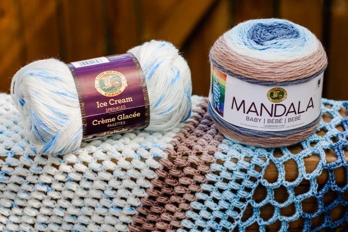 "Lion Brand Ice Cream Yarn in the color ""Cool Mint"" and Lion Brand Mandala Yarn in the color ""Wishing Well"" come together to make a beautiful free crochet shawl pattern."