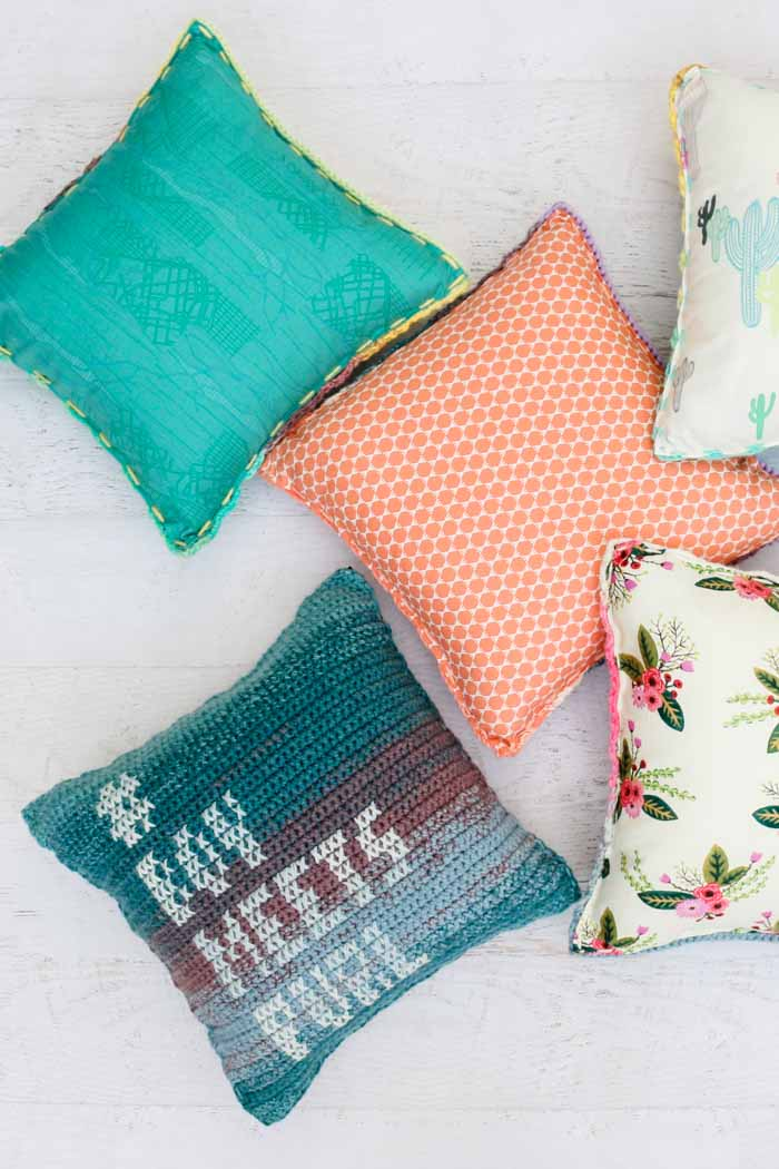 Colorful crochet pillows with personalized cross stitch messages. Adding a fabric backing makes these cushions faster to crochet.