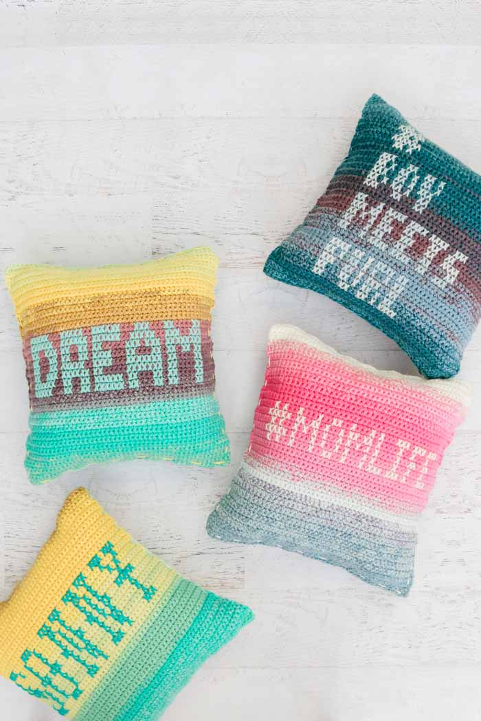 Colorful crochet pillows with personalized cross stitch messages. Such a fun crochet gift idea!
